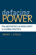 Book cover for 'Defacing Power'